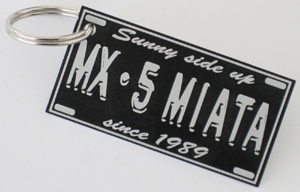Key Ring with 'MX-5 Miata - Sunny side up since 1989' emblem